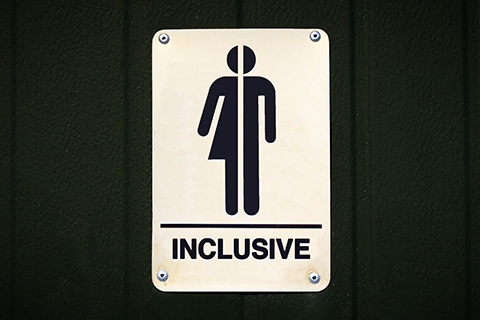 "A stock photo focused on a sign which reads ""inclusive."""