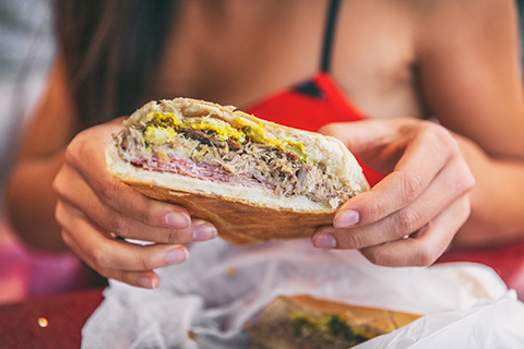 A stock photo of a zoomed in view of a Cuban sandwich.