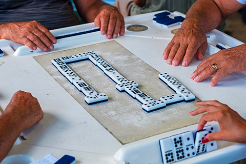 A stock photo of a zoomed in view of a game of dominos.