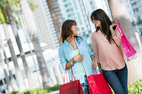 A stock photo of two women shopping in downtown Miami, Florida.