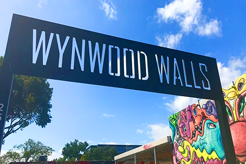 A stock photo of the sign at Wynwood Walls in the Wynwood Art District of Miami, Florida.