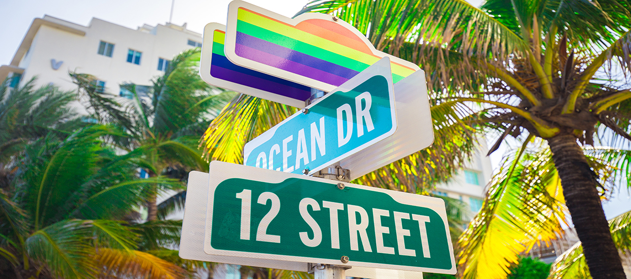 A stock photo of a street sign during the Miami Beach Pride Parade.
