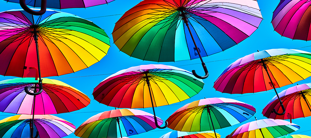 A close up photo of colorful umbrellas suspended in the air.
